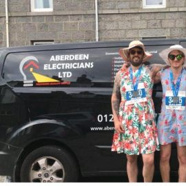 Local Electricians Run 10K for Charity in Dresses